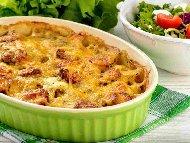 Огретен с варени картофи, македонска наденица, гъби, прясно мляко, яйца и кашкавал на фурна